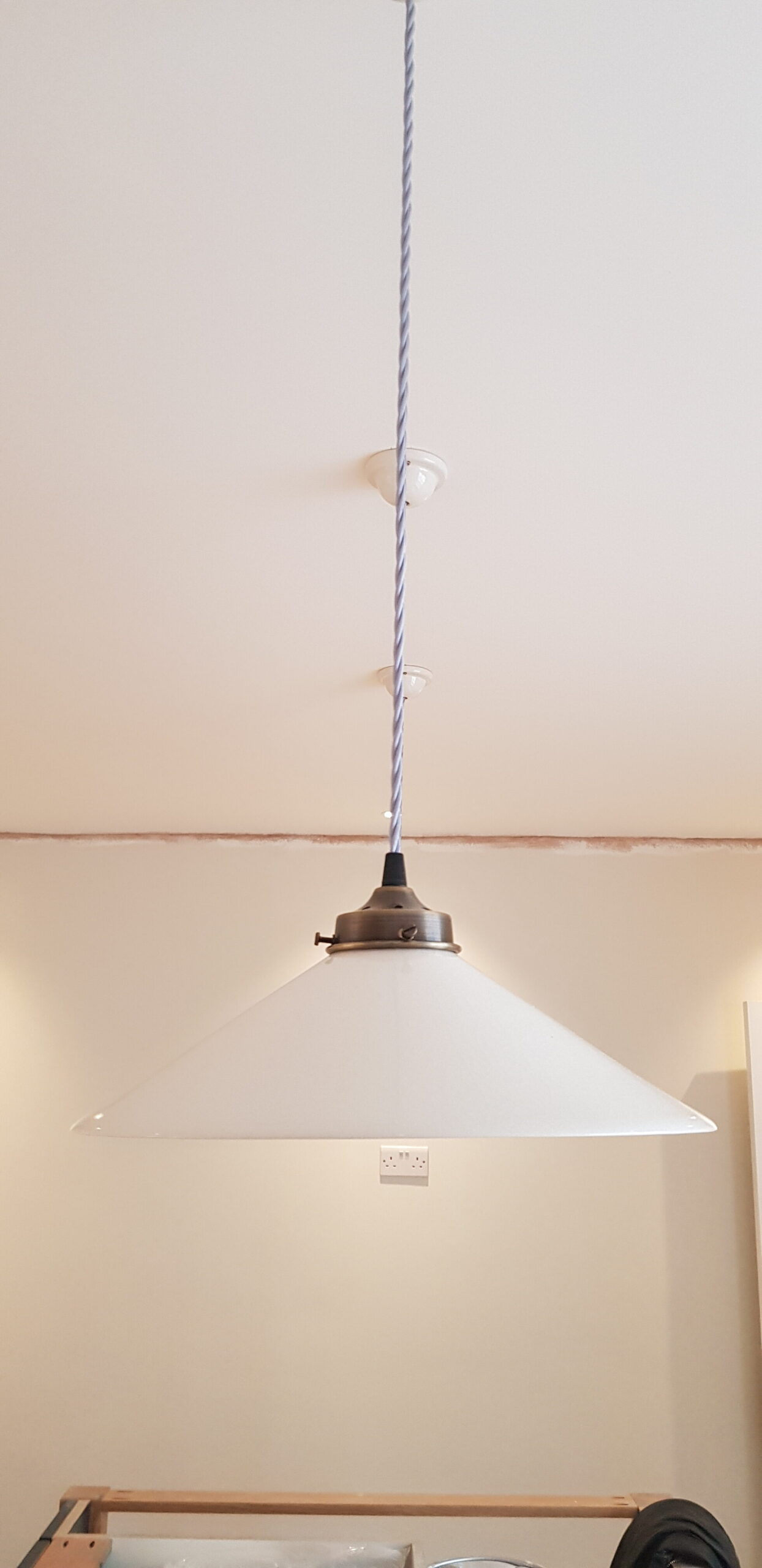 Fitting new light lamp in the refurbished kitchen